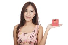 Beautiful Asian woman show red gift box on her palm hand Stock Photography