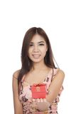 Beautiful Asian woman show red gift box on her palm hand Stock Image
