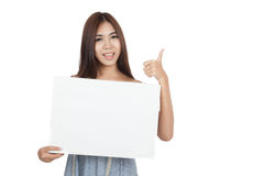 Beautiful Asian woman show thumbs up with blank sign Royalty Free Stock Photography