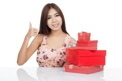 Beautiful Asian woman show thumbs up with red gift boxs Royalty Free Stock Images