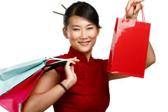 Beautiful asian woman showing multicolor shopping bags Stock Photo