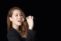 Beautiful asian woman singing. Studio shot stock photos