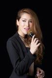 Beautiful asian woman singing Stock Images