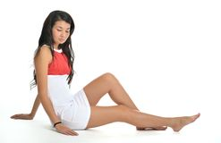 Beautiful Asian woman sitting on the floor Royalty Free Stock Photography