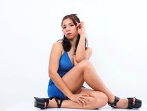 Beautiful Asian woman sitting on the floor Royalty Free Stock Photos