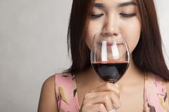 Beautiful Asian woman smell aroma of  red wine Stock Photography