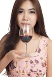 Beautiful Asian woman smell red wine Royalty Free Stock Image