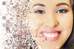 Beautiful asian woman smile with healthy teeth whitening. Photoshop effect of pixelated decomposition. Dental care concept. Implants. White Royalty Free Stock Photo
