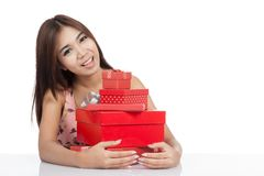 Beautiful Asian woman smile hold many red gift boxs Stock Images
