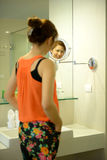 Beautiful asian woman smile with a mirror. Beautiful asian woman smile with mirror in bathroom Royalty Free Stock Photo