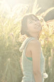 Beautiful Asian woman smile portrait with sun ray fl. Beautiful Asian woman smile portrait in the park with sun ray flare effect Stock Images