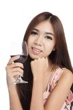 Beautiful Asian woman smile with red wine Stock Image