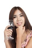 Beautiful Asian woman smile with red wine Royalty Free Stock Photos