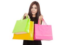 Beautiful Asian woman smile with  shopping bags in both hands Royalty Free Stock Image