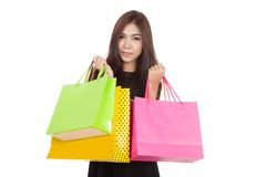 Beautiful Asian woman smile with  shopping bags in both hands Royalty Free Stock Images