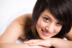Beautiful asian woman smiles at spa Stock Images