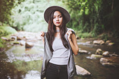 Beautiful asian woman smiling around the nature green and water Royalty Free Stock Photography
