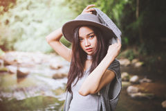 Beautiful asian woman smiling around the nature green and water Stock Photos