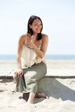 Beautiful asian woman smiling at the beach Stock Photos