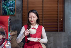 Beautiful Asian Woman Smiling with a Cup of Coffee Royalty Free Stock Image