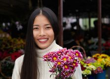 Beautiful asian woman smiling with flowers Royalty Free Stock Photos