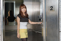 Beautiful Asian Woman Standing by Elevator royalty free stock image