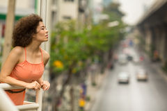 Beautiful Asian woman standing on the overpass. Street. Stock Image