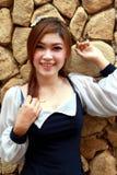 Beautiful asian woman on stone wall background Royalty Free Stock Photo