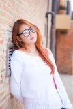 Beautiful asian woman with stone wall Stock Photo