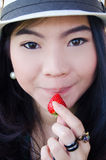 Beautiful asian woman with strawberry Stock Images