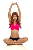 Beautiful Asian woman stretching in neon pink top Royalty Free Stock Photos