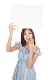 Beautiful Asian woman surprise with blank sign  over head Stock Images