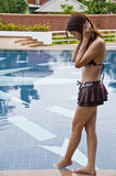 Beautiful Asian woman in swimming pool. Stock Photography