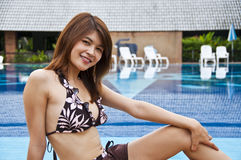 Beautiful Asian woman in swimming pool. Stock Photo