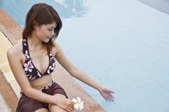 Beautiful Asian woman in swimming pool. Stock Image