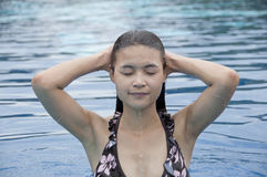 Beautiful Asian woman in swimming pool. Royalty Free Stock Photos