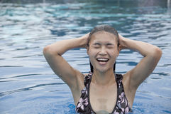 Beautiful Asian woman in swimming pool. Royalty Free Stock Photo