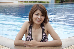 Beautiful Asian woman in swimming pool. Royalty Free Stock Photography