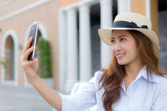 Beautiful Asian woman taking selfie Royalty Free Stock Photo