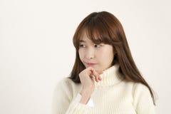 Beautiful asian woman thinking Stock Photo