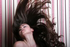 Beautiful asian woman throwing her long hair