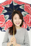 Beautiful asian woman with an umbrella Royalty Free Stock Photography
