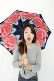 Beautiful asian woman with an umbrella Stock Image