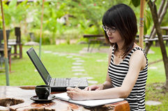 Beautiful Asian woman using computer notebook. Stock Photos