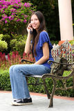 Beautiful asian woman using handphone. In the park Royalty Free Stock Photography