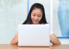 Beautiful asian woman using laptop computer. Stock Images