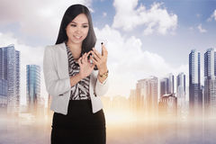 Beautiful asian woman using mobile phone Royalty Free Stock Photography