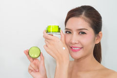 Beautiful asian woman using a natural skin care product, moistur Royalty Free Stock Image