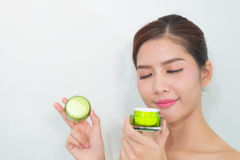 Beautiful asian woman using a natural skin care product, moistur Royalty Free Stock Photography