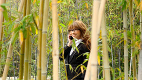 Beautiful asian woman using smart phone. In the park Stock Photo